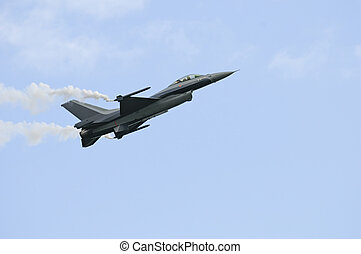 General Dynamics F16 - F16 passing by slowly with smoke pods