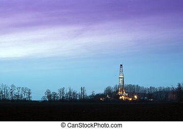 Oil rig - Oil well at night, lighting the outdoors.