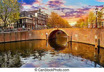 Channel in Amsterdam Netherlands houses river Amstel -...