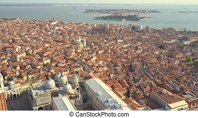 Scenic aerial shot of Venice and distant San Michele and...