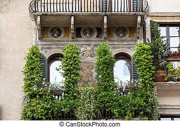 A fresco surrounds a window in Piazza delle Erbe, Verona