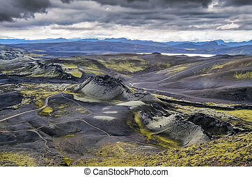 Volcanic landscape with mountains and volcano craters,...