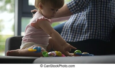 Positive cute toddler playing with a toy