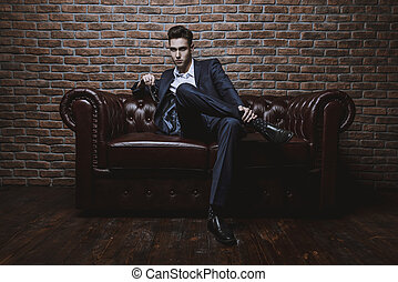 life in luxury - Imposing well dressed man in a luxurious...