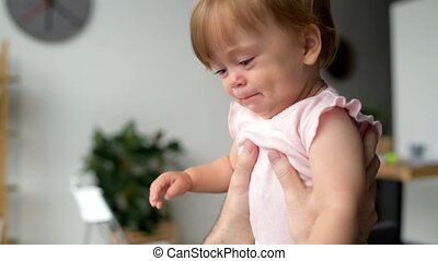 Cute toddler crying in hands of a caring father - Calm down...
