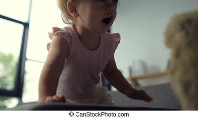 Joyful toddler having playing at home - Endless childhood....