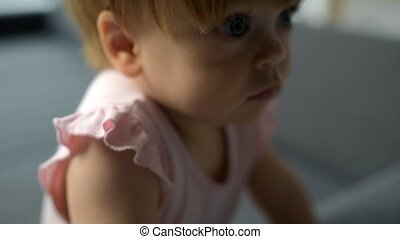 Close up of a cute toddler resting on the sofa - Curious...