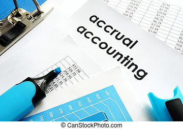 Accrual accounting document on a table.