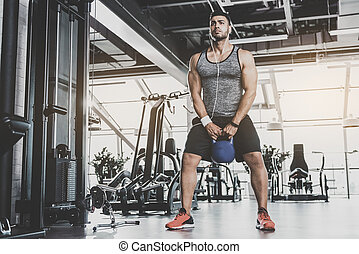 Serene man practicing with kettlebell