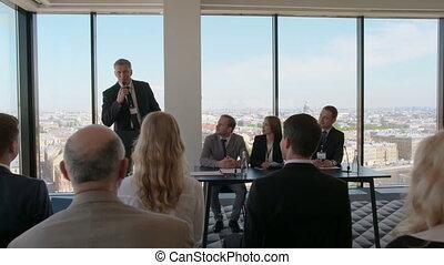 Business speaker ar seminar - Business speaker standing...