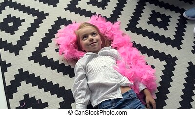 Overjoyed little girl playing with pink scarf at home - Home...