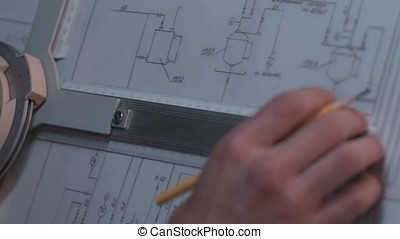 Close up of Architect hand sketching a construction project at work place. repair, building and home concept - close up of male hands making changes to blueprint.