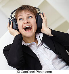 ?heerful woman singing in ear-phones