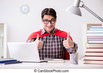 Super hero student with a laptop studying preparing for...