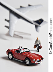 Figurine, toy car and toy airplane