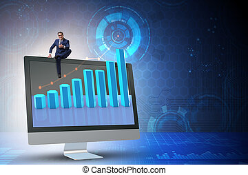 Businessman in economic forecasting concept with charts