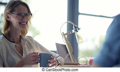Beaming lady wearing glasses having lunch talk with friend -...