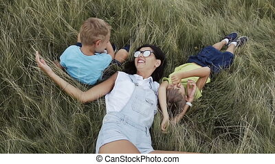 Children play with my mom in the mountains a fun family slow...