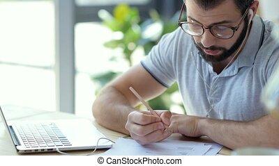 Pensive man with earphones attending online courses - Smart...