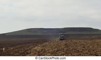 Agricultural tractor sowing and cultivating vineyard field