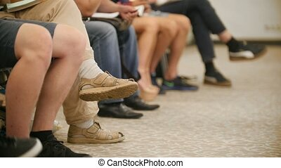 Spectators at presentation - businessmens at a conference or...