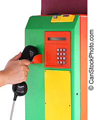 Asian Man Hand Holding The Handset Of A Public Payphone