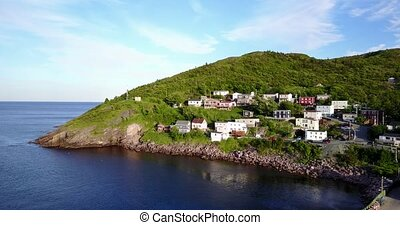 Beutiful Petty Harbour with a pier during summer sunset,...