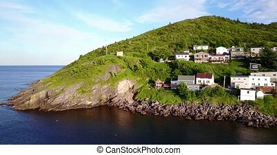 Beautiful Petty Harbour peninsula during summer sunset,...