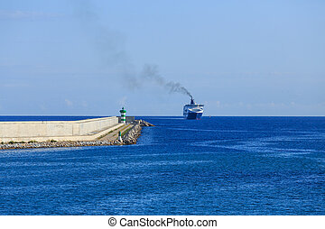 Ferry Approaching Barcelona Seawall - A green and white...
