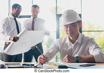 professional architects in formal wear working at modern office, businessmen group