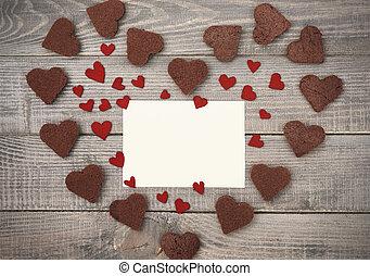 Heart shape made of chocolate hearts