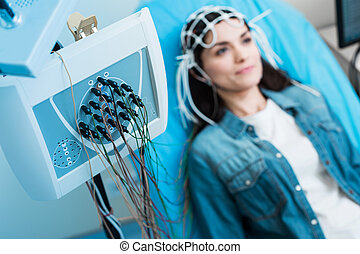 Close up of electroencephalograph recording brain waves of...