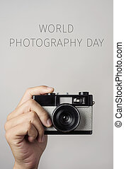 film camera and text world photography day - closeup of the...