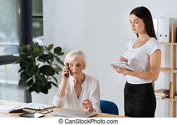Intelligent attentive woman being ready to take notes -...