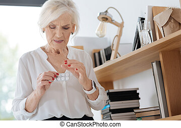 Unhappy ill woman taking pills - Strong painkillers. Unhappy...