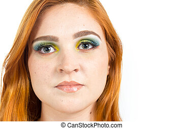 Portrait of pretty girl. Close up. Redheaded girl wearing...