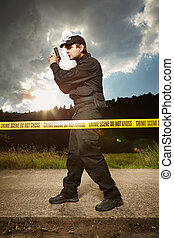 Police man in terrain uniform securing place of crime -...