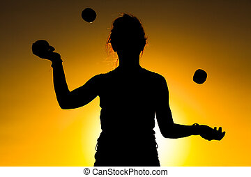 Woman Juggler - Silhouette of a Woman Juggling with Balls at...