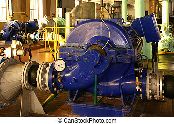 Water pumping station - industrial interior and pipes.