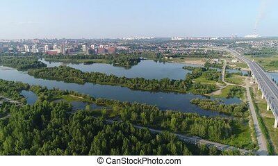 the flight of the drone over the river. Small Islands of trees and shrubs