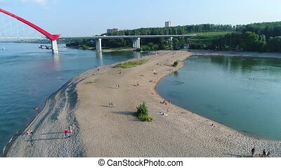 drone flight over the river. sand beach
