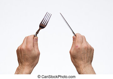 Knife and fork in hands