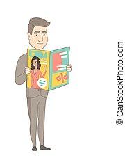 Successful caucasian businessman reading magazine.