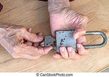 Hands of an old woman with an old-fashioned lock - The hands...