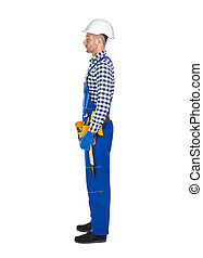 Side view of young construction worker in uniform and tool belt
