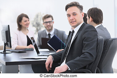 business team with a senior Manager in the foreground -...