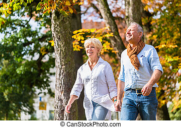 Senior man and woman embracing each other in love