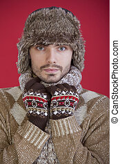 man in fur hat and sweater