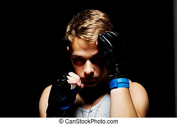 The teenage boxer. - Photo of muscular teenager boxing on...
