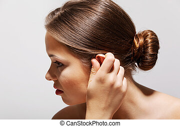 Tinnitus. Closeup up side profile sick female having ear...